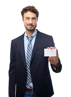 Man in suit holding a card