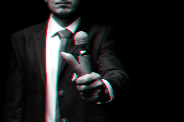 Man in a suit is holding pink vibrators for sex. black and white with 3d glitch virtual reality effect