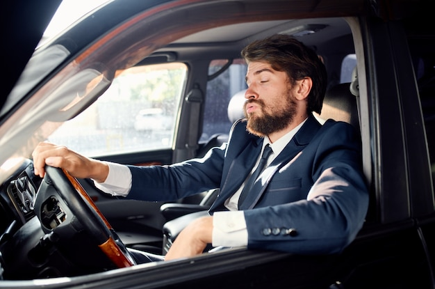 Man in suit looking out of the car window salam suit business finance.