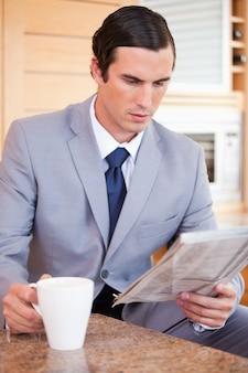 Man in suit making breakfast