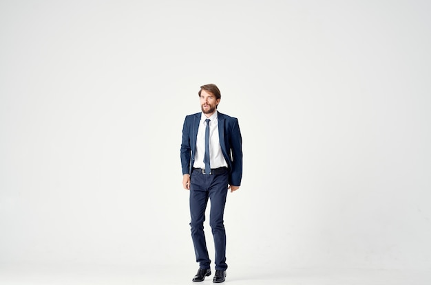Man in suit manager office emotions motion light background. high quality photo