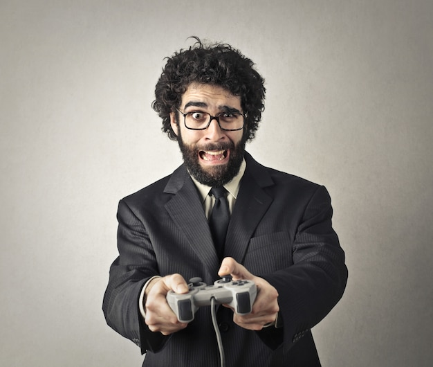 Man in suit playing on a videogame