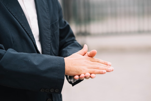 Man in suit rubbing hands