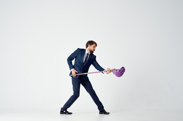 Man in a suit with a mop in his hands emotions cleaning official