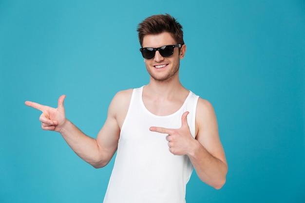 Man in sunglasses pointing isolated