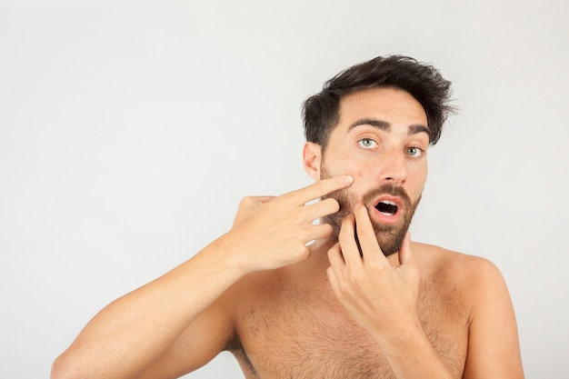 Man surprised with a new pimple