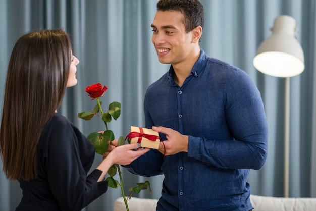 Man surprising his girlfriend with a cute gift