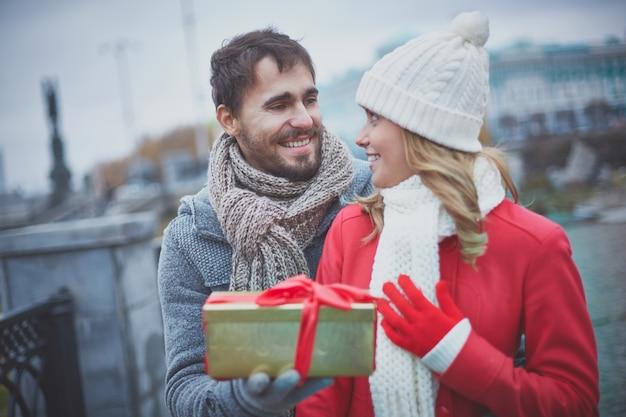 Man surprising his girlfriend