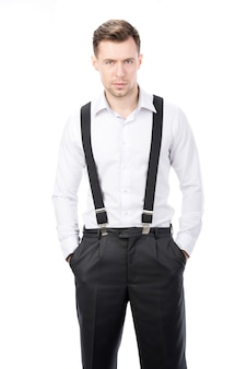 A man in suspenders is standing
