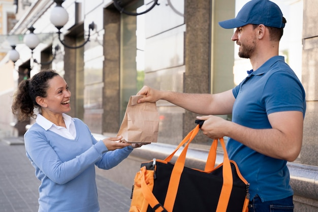 Man in t-shirt delivering takeaway food