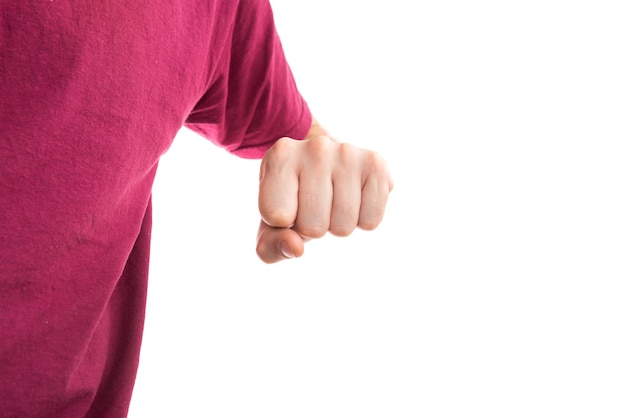 Man in t-shirt with clenched fist isolated on white background