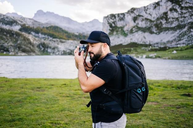 A man take photos in a mountain landscape