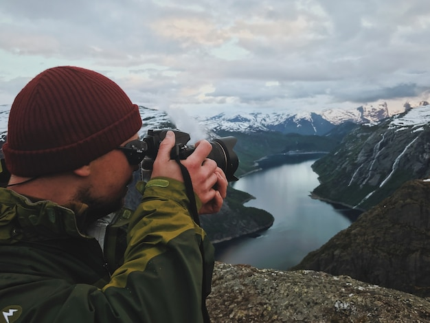 Man takes a picture of gorgeous scandinavian landscape