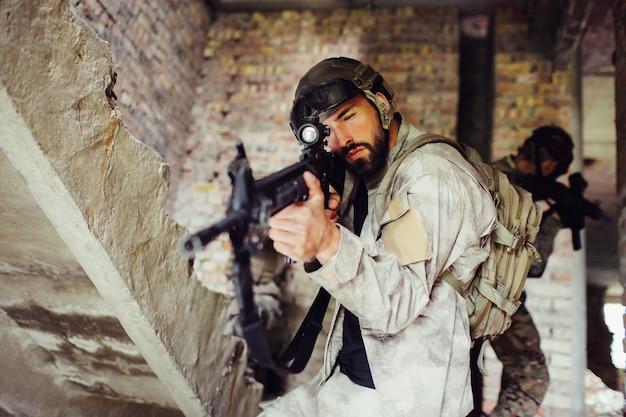 Man taking aim through rifle's lens. he is looking straight forward.