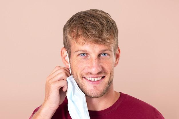 Man taking mask off during the new normal