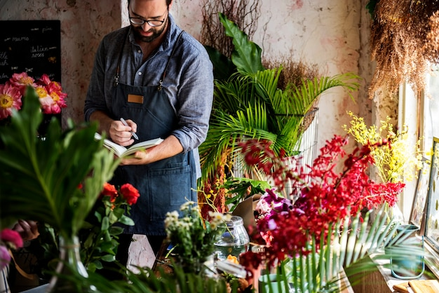 Man taking notes in a flower shop