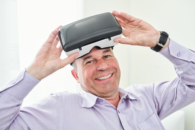 Man taking off vr goggles