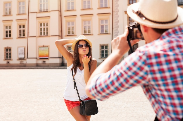 Man taking photo of his girlfriend