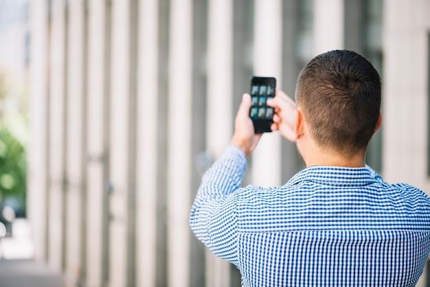Man taking photo Free Photo