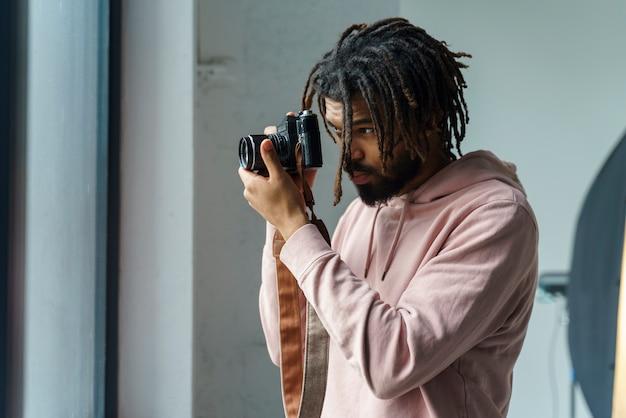 Man taking photos indoors
