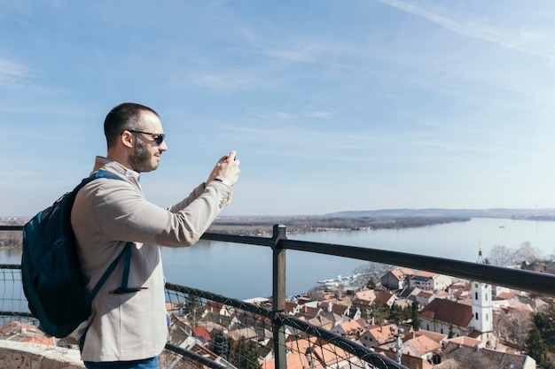 Man taking pictures of city