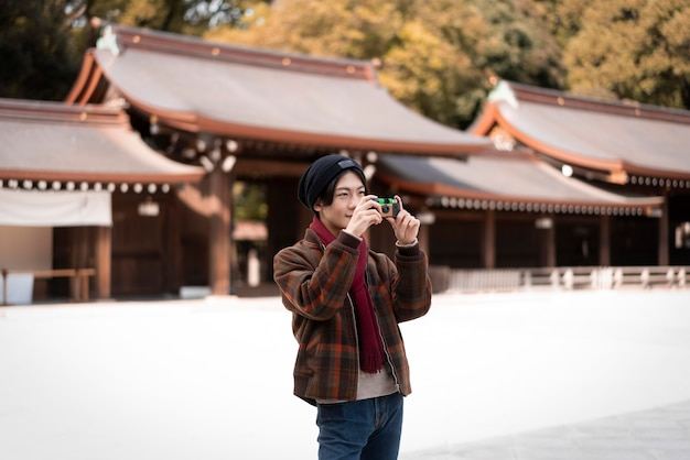 Man taking pictures outdoors with camera