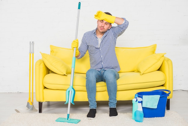 Man taking a rest after cleaning