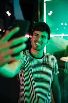 Man taking a selfie and smile in the night