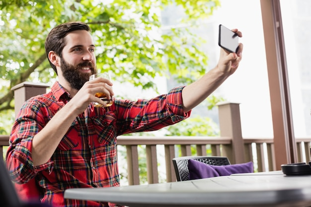 Man taking a selfie while having drink
