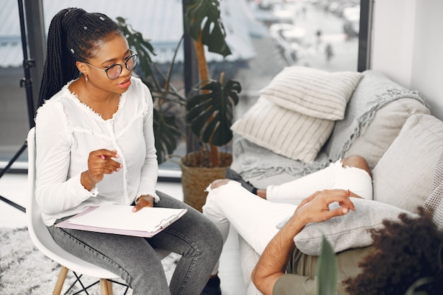 Man talking to lady psychologist during session
