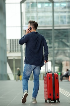 Man talking on mobile phone in airport
