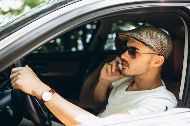 Man talking on the phone and driving in the car