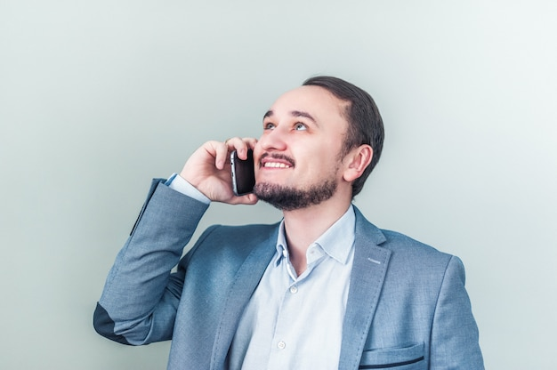 Man talking on the phone, looks up and smiles