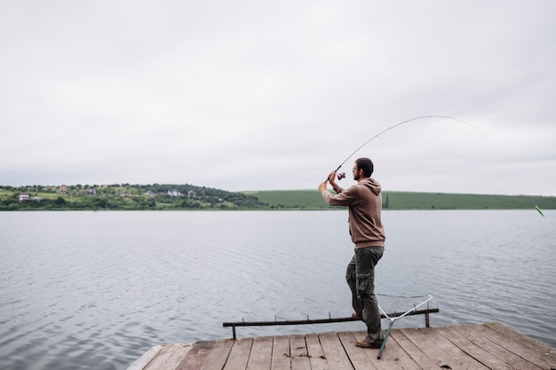 Man throwing fishing line in the lake
