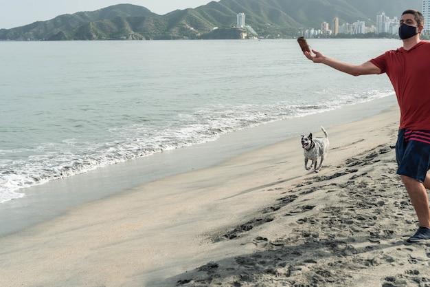 Man throwing toy to dog