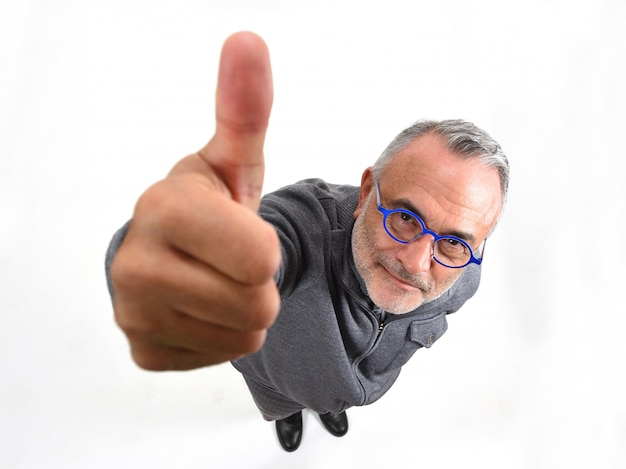 Man thumps up on white background