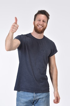 Man thumps up on white
