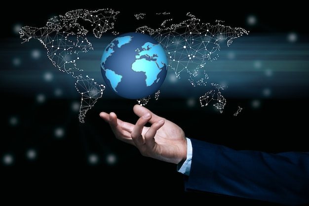 Man touching in globe in screen