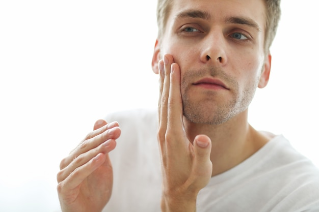 Man touching his beard, ready for shaving.