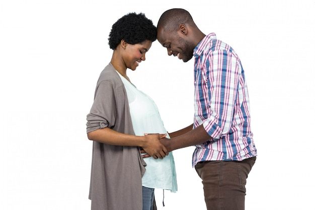 Man touching pregnant woman stomach
