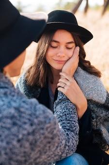 Man touching pretty young girl