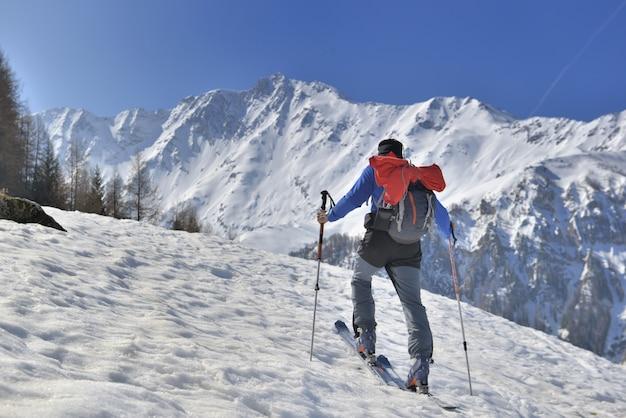 Man in touring ski