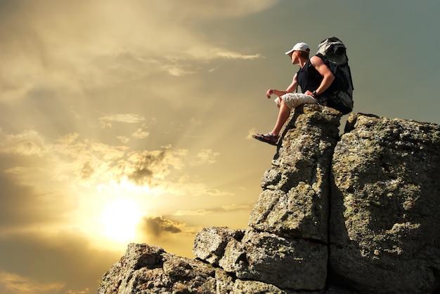 Man tourist on top of mountain