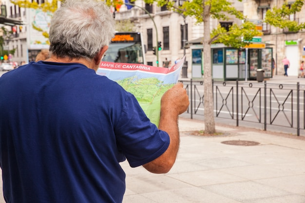 Man tourist with map on the street