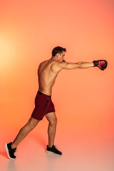 Man training with boxing gloves full shot