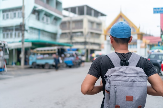Man travel around the world with backpack freedom and relax life.