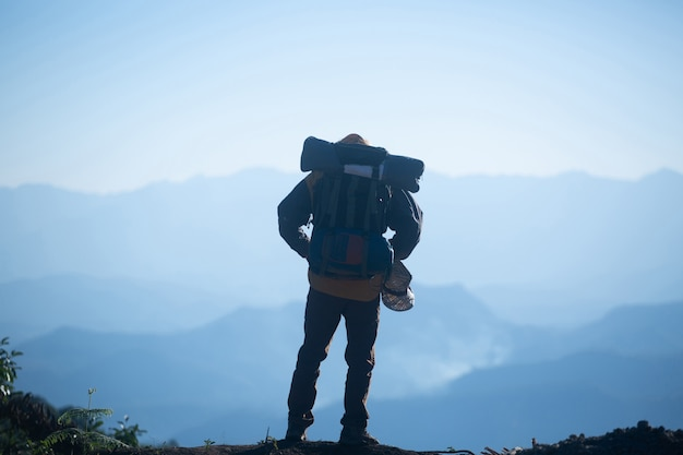 Man traveler with backpack mountaineering travel lifestyle concept