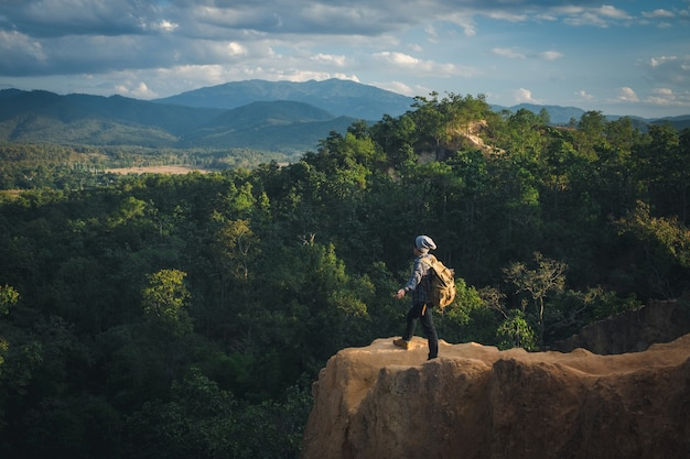 Man traveler with backpack mountaineering travel lifestyle concept.