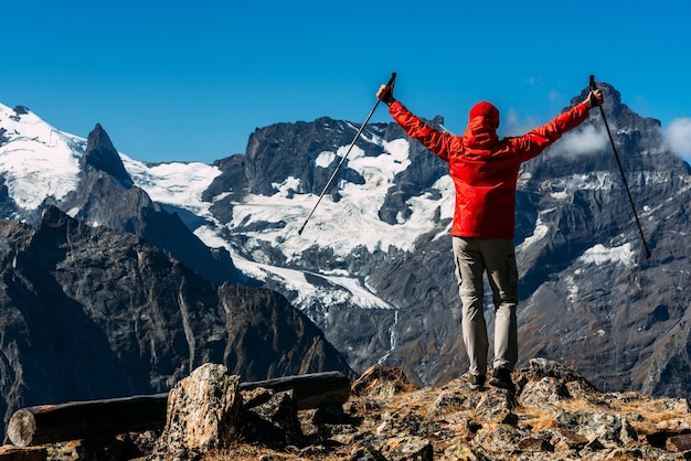 A man traveling in the caucasus. mountain sports. athlete happy finish. mountain tourism. walking tour. the journey to the mountains. nordic walking among the mountains. copy space