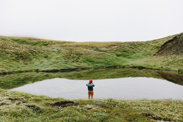 Man traveller walk arund icelandic landscape